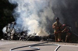 Motor home engulfed in flames along Highway 126W